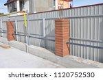 building metal  bricks fence... | Shutterstock . vector #1120752530