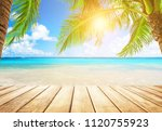 coconut palm trees against blue ... | Shutterstock . vector #1120755923