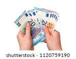 Euro Banknotes In Hands On A...