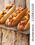 delicious chili hot dogs with... | Shutterstock . vector #1120813103