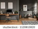 posters on grey wall above... | Shutterstock . vector #1120813820