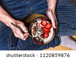 eating healthy breakfast bowl....   Shutterstock . vector #1120859876