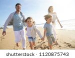 Family Running On Sandy Beach...