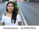 candid of ethnic woman on the... | Shutterstock . vector #1120902026