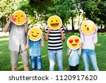 happy family holding up emojis | Shutterstock . vector #1120917620