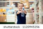 little boy in the supermarket...   Shutterstock . vector #1120945256