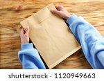 woman holding envelope on... | Shutterstock . vector #1120949663