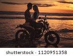 seductive couple hugging on... | Shutterstock . vector #1120951358