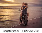 couple hugging on motorcycle on ... | Shutterstock . vector #1120951910