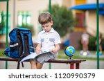 cute little schoolboy studying... | Shutterstock . vector #1120990379