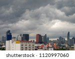 Small photo of A group of black clouds are formed and gathered over the city before the storm comes or before it rains