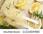 frozen fruit ice with lemon and ... | Shutterstock . vector #1121004980
