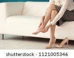 tired young woman feeling ache... | Shutterstock . vector #1121005346