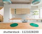 modern white kitchen cabinets... | Shutterstock . vector #1121028200