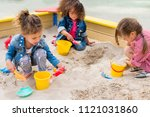 three multiethnic little... | Shutterstock . vector #1121031860