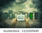 hands holding a sheet with... | Shutterstock . vector #1121035640