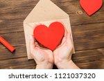 top view. hand of girl writing... | Shutterstock . vector #1121037320