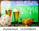 beer glasses and chips in front ... | Shutterstock . vector #1121038643
