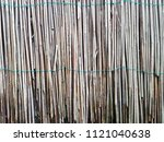 the texture of the dry reeds.... | Shutterstock . vector #1121040638