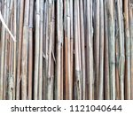 the texture of the dry reeds.... | Shutterstock . vector #1121040644
