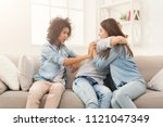 young women talking and... | Shutterstock . vector #1121047349