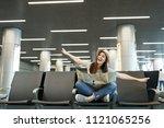 young joyful traveler tourist... | Shutterstock . vector #1121065256