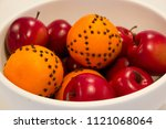 white bowl with red apples and... | Shutterstock . vector #1121068064