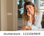 young beautiful woman wearing a ... | Shutterstock . vector #1121069849