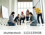 young creative diverse group... | Shutterstock . vector #1121135438