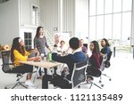 group of multiracial young... | Shutterstock . vector #1121135489