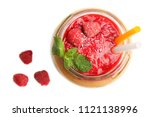 smoothies with raspberries in a ... | Shutterstock . vector #1121138996