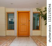 contemporary apartment building main entrance wooden door and ornate floor