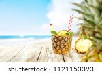fresh pineapple and summer time.... | Shutterstock . vector #1121153393