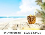 fresh pineapple and summer time.... | Shutterstock . vector #1121153429