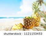 fresh pineapple and summer time.... | Shutterstock . vector #1121153453
