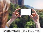 hipster blogger girl holds... | Shutterstock . vector #1121172746