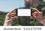 hipster blogger girl holds... | Shutterstock . vector #1121172749