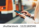 blogger hipster using in hands... | Shutterstock . vector #1121183540