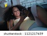 happy african american teen... | Shutterstock . vector #1121217659