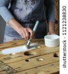 woman holding a paint brush | Shutterstock . vector #1121238830