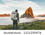 backpacker man exploring sunset ... | Shutterstock . vector #1121250476