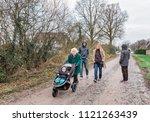 multi generational family... | Shutterstock . vector #1121263439