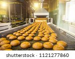cakes on automatic conveyor... | Shutterstock . vector #1121277860