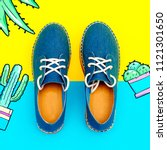 jeans moccasins on the platform.... | Shutterstock . vector #1121301650