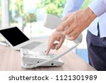 man dialing number on telephone ... | Shutterstock . vector #1121301989