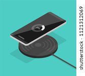 smartphone wireless charging in ... | Shutterstock .eps vector #1121312069