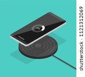 smartphone wireless charging in ... | Shutterstock .eps vector #1121312069