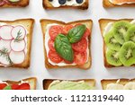 various toasts with tomatoes ... | Shutterstock . vector #1121319440