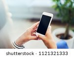 closeup of smartphone held by... | Shutterstock . vector #1121321333