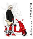 beautiful girl in a stylish... | Shutterstock .eps vector #1121329730